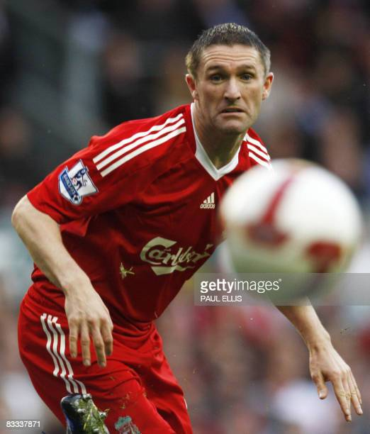 Liverpool's Irish forward Robbie Keane watches his shot go wide against Wigan Athletic during their English Premier League football match at Anfield...