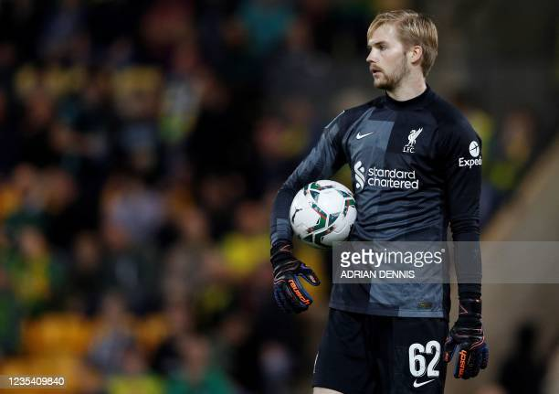 Liverpool's Irish goalkeeper Caoimhin Kelleher holds the ball during the English League Cup third round football match between Norwich City and...