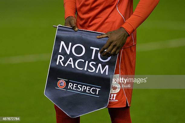 Liverpool's Italian striker Mario Balotelli holds a Respect antiracism banner before kick off of the UEFA Champions League group B football match...