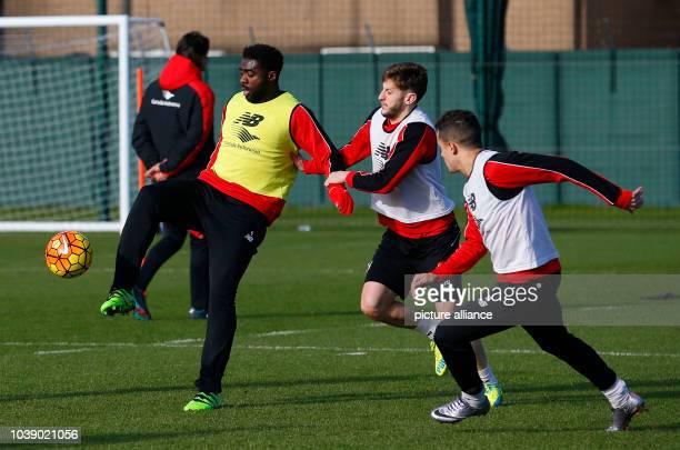 Liverpool's Ivorian defender Kolo Toure Liverpool's English midfielder Adam Lallana and Liverpool's Brazilian midfielder Philippe Coutinho in action...
