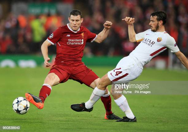 Liverpool's James Milner and AS Roma's Alessandro Florenzi battle for the ball during the UEFA Champions League Semi Final First Leg match at Anfield...