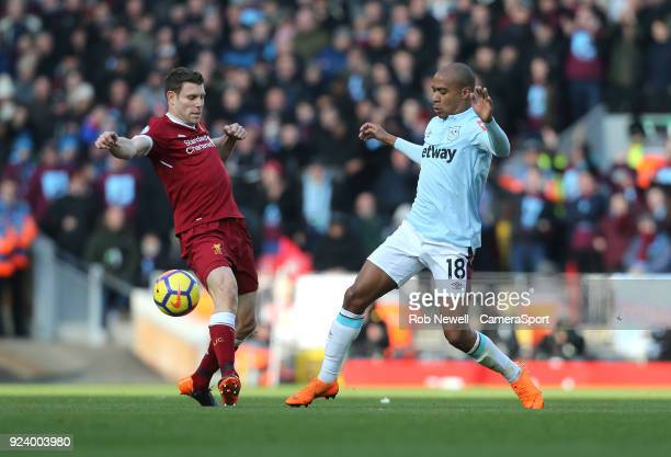 Liverpool's James Milner and West Ham United's Joao Mario during the Premier League match between Liverpool and West Ham United at Anfield on...