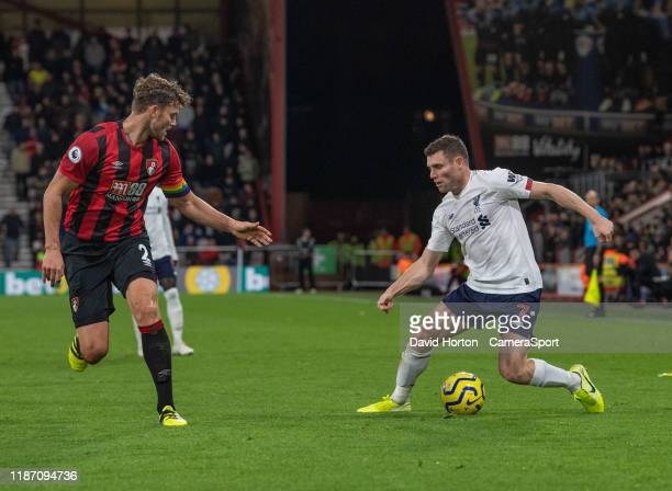 Liverpool's James Milner battles with Bournemouth's Simon Francis during the Premier League match between AFC Bournemouth and Liverpool FC at...