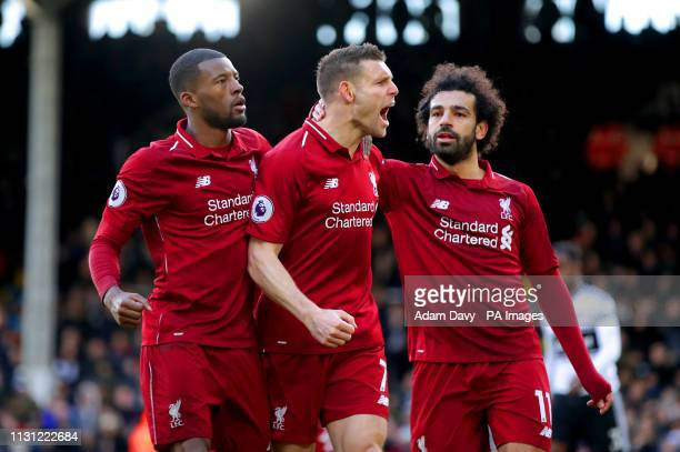 Liverpool's James Milner celebrates scoring his side's second goal of the game during the Premier League match at Craven Cottage London