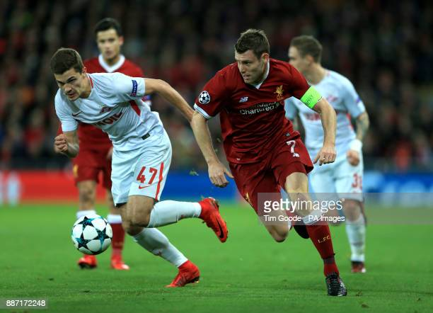 Liverpool's James Milner gets away from Spartak Moscow's Roman Zobnin during the UEFA Champions League Group E match at Anfield Liverpool