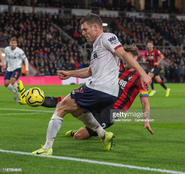 Liverpool's James Milner is tackled by Bournemouth's Simon Francis during the Premier League match between AFC Bournemouth and Liverpool FC at...