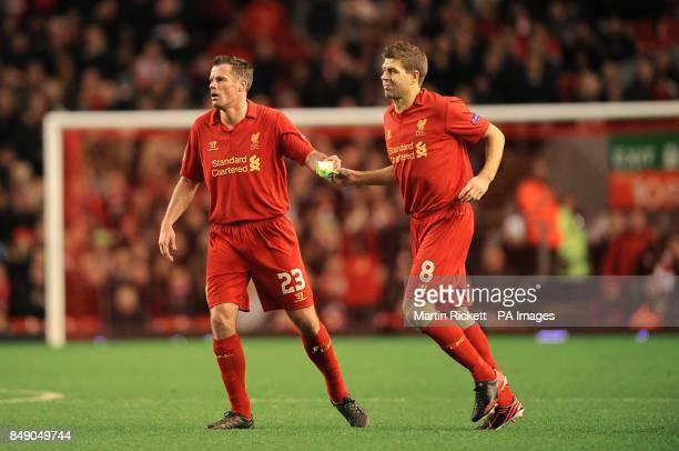 Liverpool's Jamie Carragher hands the captains armband to Steven Gerrard