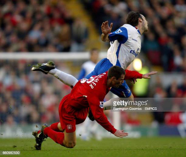 Liverpool's Jamie Carragher sends Crystal Palace's Dougie Freedman flying through the air