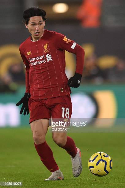 Liverpool's Japanese midfielder Takumi Minamino controls the ball during the English Premier League football match between Wolverhampton Wanderers...