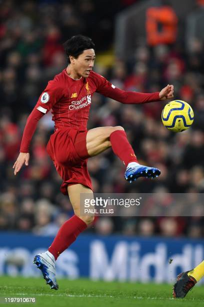 Liverpool's Japanese midfielder Takumi Minamino controls the ball during the English Premier League football match between Liverpool and Southampton...