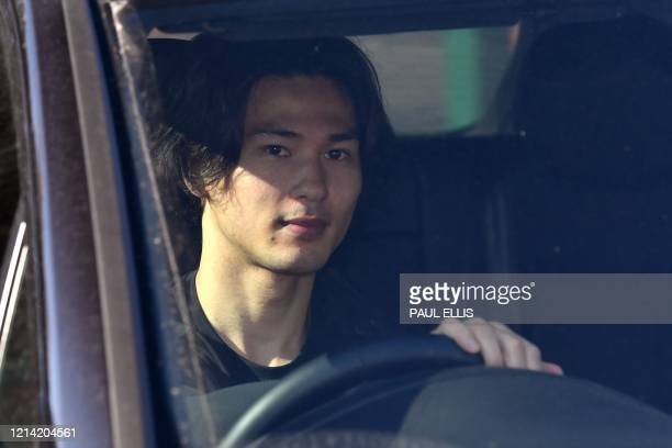 Liverpool's Japanese midfielder Takumi Minamino leaves from Liverpool's training ground at Melwood in Liverpool north west England on May 20 as...