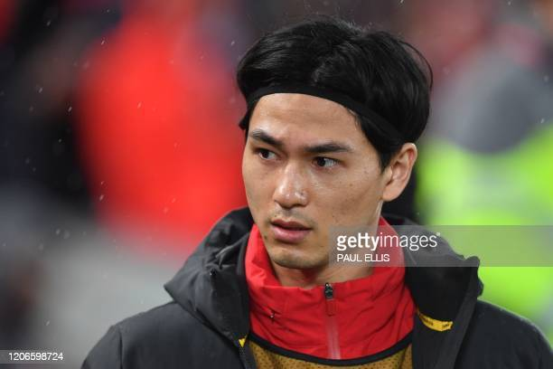 Liverpool's Japanese midfielder Takumi Minamino looks on before the UEFA Champions league Round of 16 second leg football match between Liverpool and...