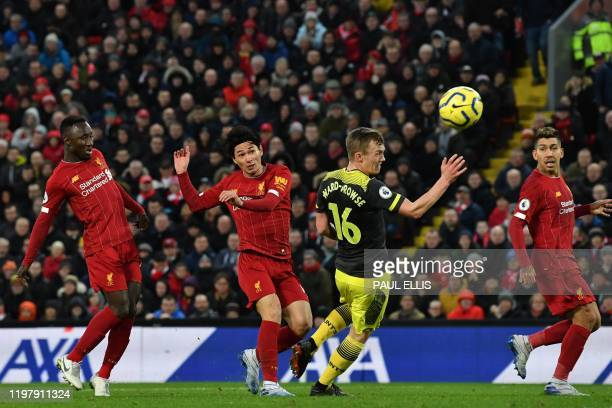 Liverpool's Japanese midfielder Takumi Minamino misses a chance at goal during the English Premier League football match between Liverpool and...