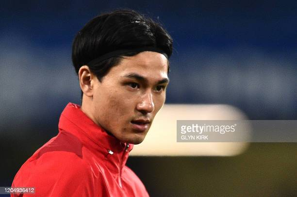 Liverpool's Japanese midfielder Takumi Minamino reacts ahead of the English FA Cup fifth round football match between Chelsea and Liverpool at...