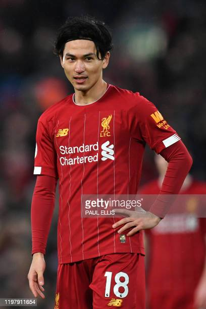 Liverpool's Japanese midfielder Takumi Minamino reacts during the English Premier League football match between Liverpool and Southampton at Anfield...