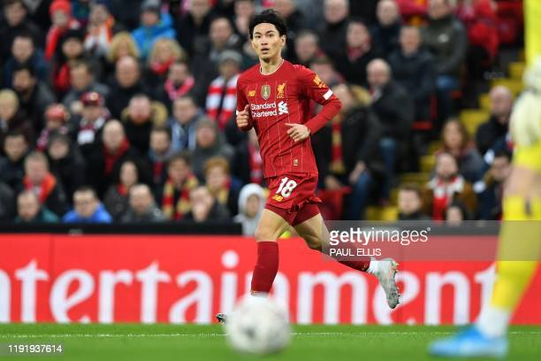 Liverpool's Japanese midfielder Takumi Minamino runs during the English FA Cup third round football match between Liverpool and Everton at Anfield in...