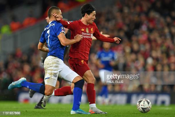 Liverpool's Japanese midfielder Takumi Minamino vies with Everton's Brazilian striker Richarlison during the English FA Cup third round football...