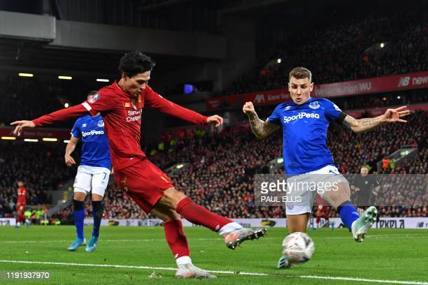 Liverpool's Japanese midfielder Takumi Minamino vies with Everton's French defender Lucas Digne during the English FA Cup third round football match...