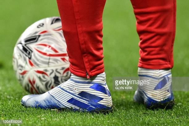 Liverpool's Japanese midfielder Takumi Minamino warms up ahead of the English FA Cup fifth round football match between Chelsea and Liverpool at...