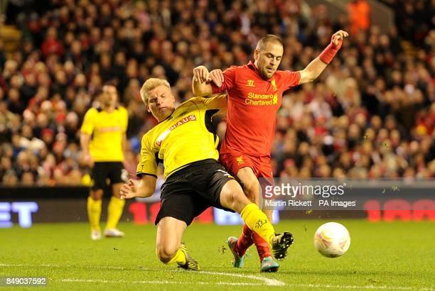Liverpool's Joe Cole and Young Boys' Juhani Ojala battle for the ball