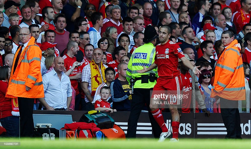 Liverpool's Joe Cole reacts after being sent off for a tackle on Arsenal's Laurent Koscielny during their English Premier League football match at Anfield in Liverpool, north-west England, on August 15, 2010.
