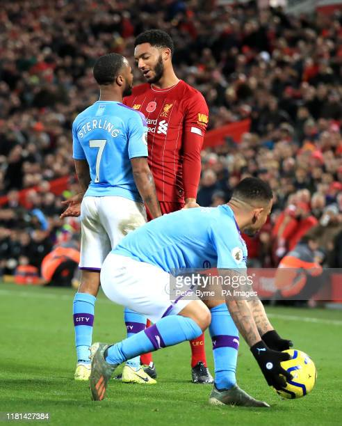Liverpool's Joe Gomez and Manchester City's Raheem Sterling clash during the Premier League match at Anfield Liverpool