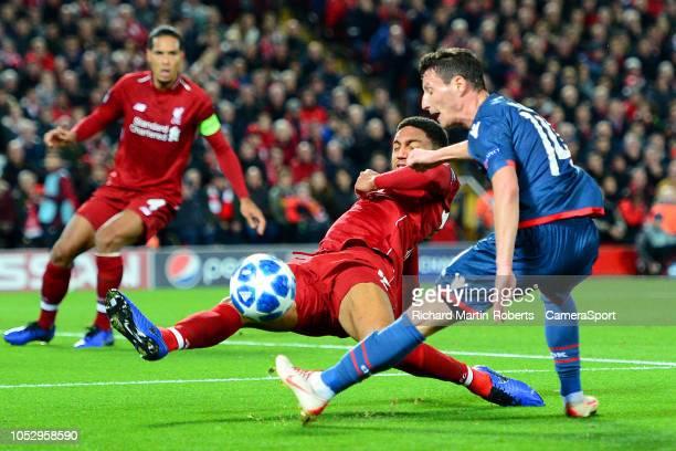 Liverpool's Joe Gomez blocks the shot of Crvena Zvezda's Slavoljub Srnic during the Group C match of the UEFA Champions League between Liverpool and...