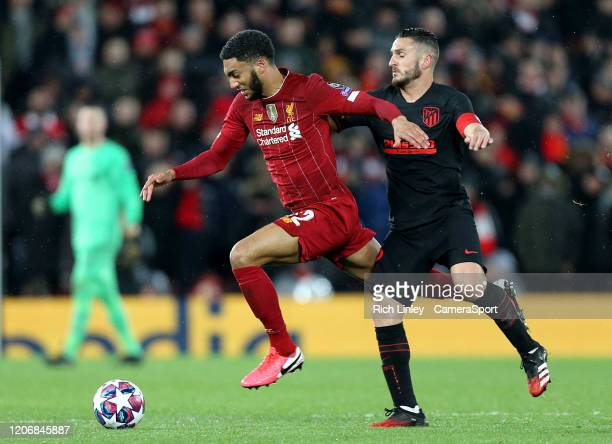 Liverpool's Joe Gomez under pressure from Atletico Madrid's Koke during the UEFA Champions League round of 16 second leg match between Liverpool FC...