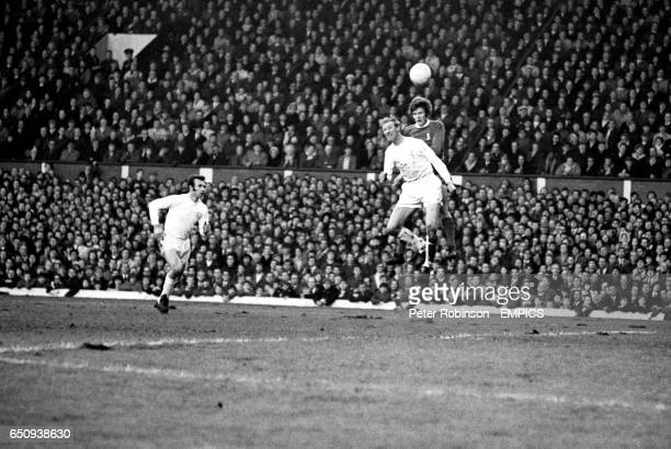 Liverpool's John Toshack beats Leeds United's Jackie Charlton in the air watched by Leeds United's Paul Reaney