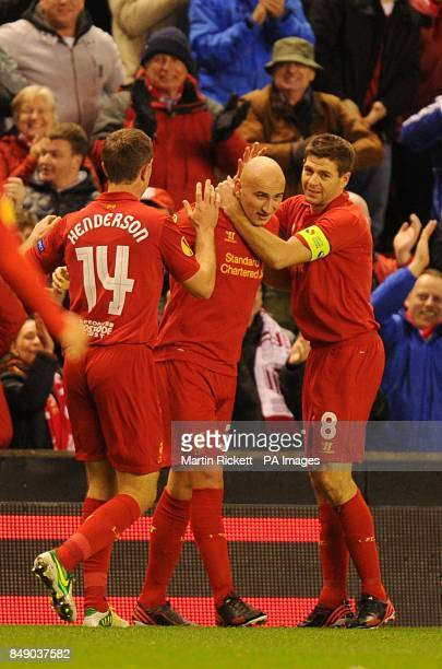 Liverpool's Jonjo Shelvey celebrates scoring his teams first goal of the game with teammates Jordan Henderson and Steven Gerrard