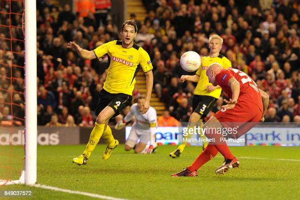 Liverpool's Jonjo Shelvey heads the ball to score his teams first goal of the game