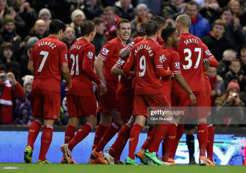 Liverpool's Jordan Henderson and team mates celebrate after Daniel Agger has scored the first goal during the Barclays Premier League match between Liverpool and Hull City at Anfield on January 1, 2014 in Liverpool, England.