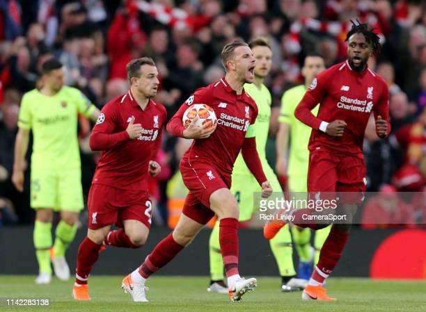 Liverpool's Jordan Henderson celebrates after Divock Origi scored the opening goal during the UEFA Champions League Semi Final second leg match...