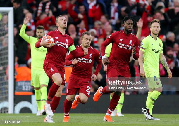 Liverpool's Jordan Henderson celebrates after Divock Origi scored the opening goal during the UEFA Champions League Semi Final second leg match...