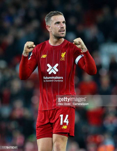 Liverpool's Jordan Henderson celebrates after the Premier League match between Liverpool FC and Tottenham Hotspur at Anfield on October 27 2019 in...