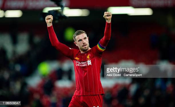 Liverpool's Jordan Henderson celebrates after the Premier League match between Liverpool FC and Everton FC at Anfield on December 4 2019 in Liverpool...