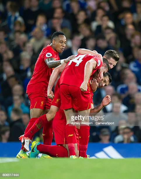Liverpool's Jordan Henderson celebrates scoring his sides second goal with teammates during the Premier League match between Chelsea and Liverpool at...