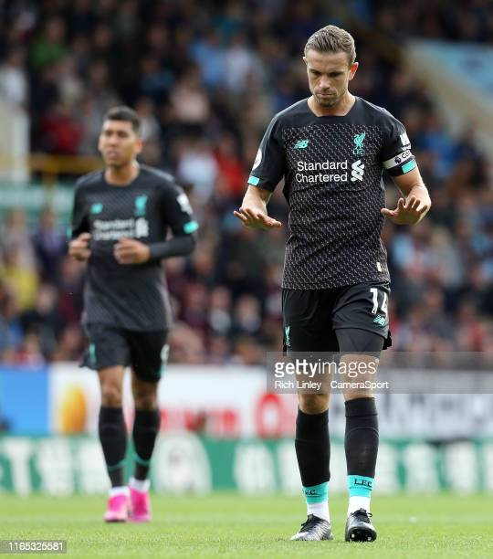 Liverpool's Jordan Henderson gestures during the Premier League match between Burnley FC and Liverpool FC at Turf Moor on August 31 2019 in Burnley...