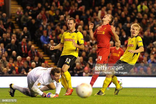 Liverpool's Jordan Henderson reacts as his shot is saved by Young Boys goalkeeper Marco Wolfli