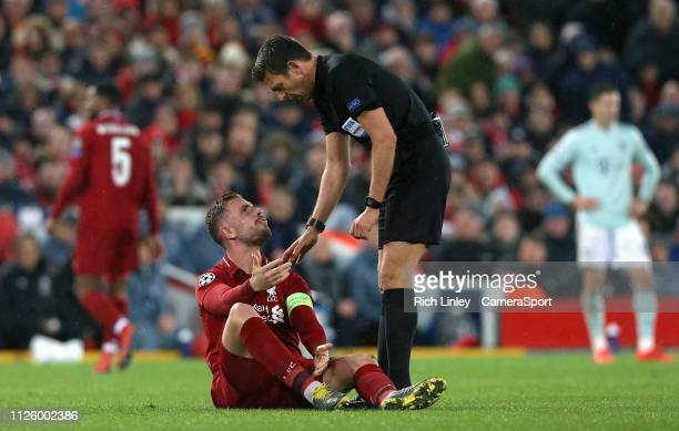 Liverpool's Jordan Henderson remonstrates with Referee Gianluca Rocchi after falling victim to a hard tackle during the UEFA Champions League Round...
