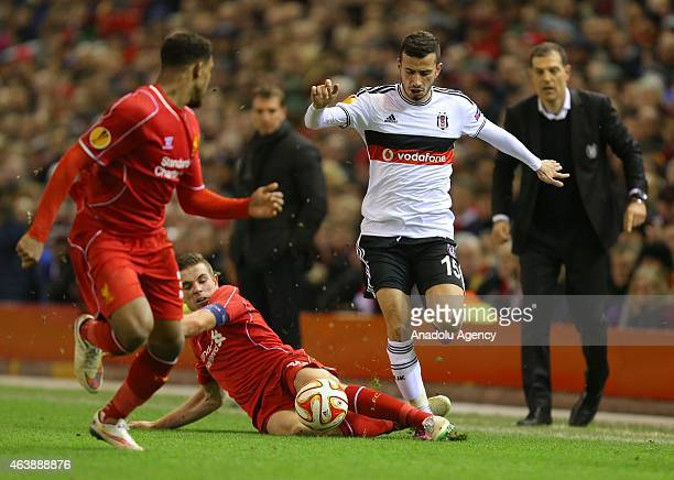 Liverpool's Jordan Henderson tackles Besiktas' Oguzhan Ozyakup during the UEFA Europa League Round of 32 match between Liverpool FC and Besiktas JK...