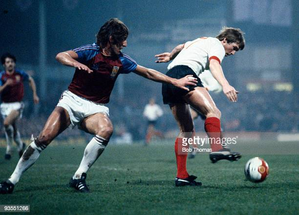 Liverpool's Kenny Dalglish controls the ball challenged by West Ham United's Billy Bonds during the League Cup Final replay between Liverpool and...