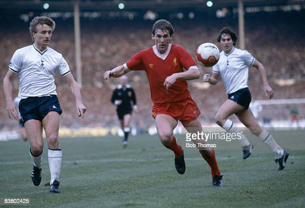 Liverpool's Kenny Dalglish moves onto the ball watched by Tottenham Hotspur defenders Paul Price and Paul Miller during the League Cup Final at...