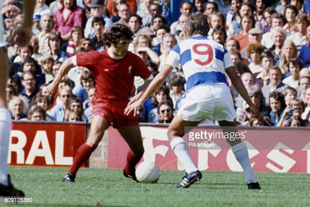 Liverpool's Kevin Keegan confronts Queens Park Ranger's Don Masson