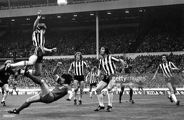 Liverpool's Kevin Keegan tries an overhead kick past John Tudor in the FA Cup Final against Newcastle United at Wembley Stadium Liverpool went on to...