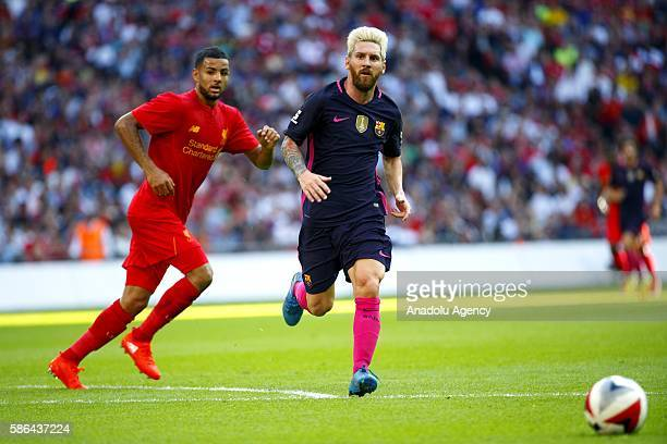 Liverpool's Kevin Stewart vies with Barcelona's Lionel Messi during an International Champions Cup match between Liverpool FC and FC Barcelona at...