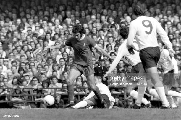 Liverpool's Larry Lloyd beats Derby County's John McGovern to the ball watched by Derby's Kevin Hector John O'Hare and Archie Gemmill