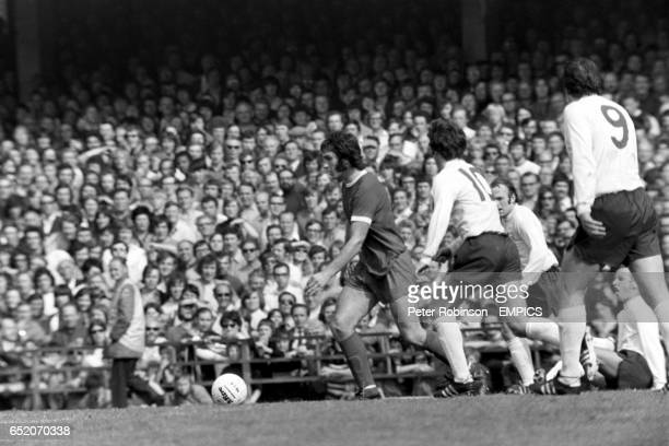 Liverpool's Larry Lloyd looks for a teammate to pass to as he is pursued by Derby County's Kevin Hector and Archie Gemmill