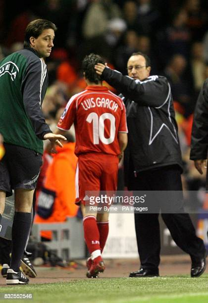 Liverpool's Luis Garcia is congratulated by manager Rafael Benitez as he comes off the field