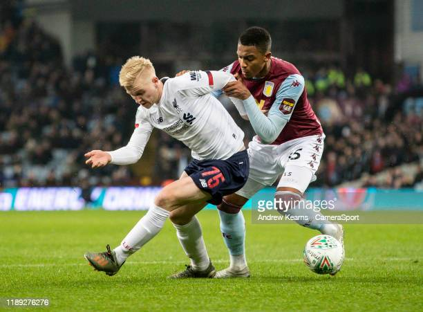 Liverpool's Luis Longstaff competing with Aston Villa's Ezri Konsa during the Carabao Cup Quarter Final match between Aston Villa and Liverpool FC at...